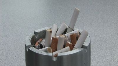 Putting out Cigarette in Ash Tray Free Stock Video