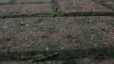 Rain Drops Hitting a Stone Brick Floor