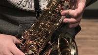 Musician Plays A Gold Saxophone