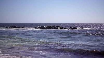 Rocks In Water Hit By Waves 4K