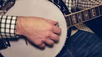 Man Playing the Banjo - Sitting/Straight Shot in 4K