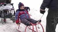 Kid on sled