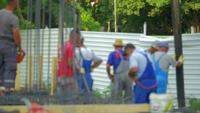 Defocused construction workers 4K stock video