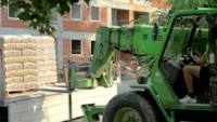 Blurred forklift carrying materials 4K stock video