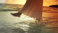 Woman splashing feet in the ocean