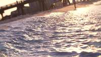 Waves-rolling-up-to-shore-in-slow-motion