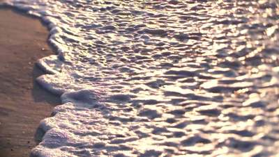 Close up waves in slow motion on the shore