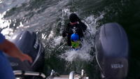 Scuba diver jumps off boat into water