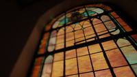 Under stained glass in a church