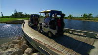 Golf carts drive over bridge