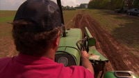 Man drives tractor