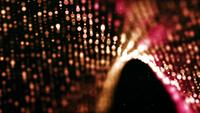 Undulating mesh formed with red bokeh lights