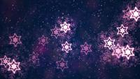 Purple stars snowflakes and particles floating on dark background