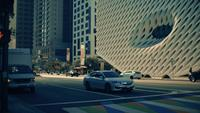 Horizontal panning shot of stop light and crosswalk at downtown of Los Angeles in 4K