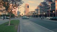 Tracking shot of streets and crosswalk at Los Angeles in 4K