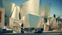 Slow panning shot going right of the frontage of the Walt Disney Concert Hall at Los Angeles in 4K.