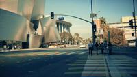 Panning shot going left from a crosswalk to the frontage of the Walt Disney Concert Hall at Los Angeles in 4K.