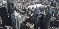 4K Aerial drone shot of BNY Mellon Center, Comscast Center and Liberty Place buildings on Philadelphia