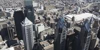 4K Tiro panorâmico aéreo do BNY Mellon Center, Comscast Center e Liberty Place em Philadelphia