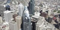 4K Aerial drone shot of Liberty Place buildings with sunlight reflections on Philadelphia