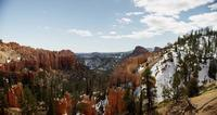 Horizontal panning shot of a red canyon and a snowy peaks in 4K