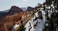 Horizontal panning shot of a red canyon and a snowy valleys in 4K
