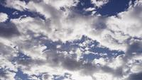 Time lapse of bright and gray altocumulus clouds moving from right to left in 4K