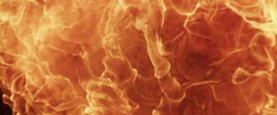 Fire ignition creating a fireball and orange texture in 4K