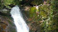Young-men-cliff-jumping-off-of-a-waterfall-free-stock-footage