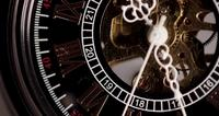 Extreme close up of pocket watch with exposed machinery working for a minute in 4K