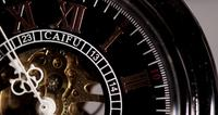 Extreme close up of pocket watch with exposed machinery working for thirty seconds in 4K