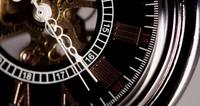 Extreme close up of pocket watch with white clock hands and exposed machinery working fourty  seconds in 4K time lapse