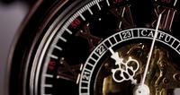 Extreme close up of pocket watch with white hands and exposed machinery working twenty seven seconds in 4K time lapse