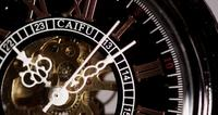 Extreme close up of pocket watch with exposed machinery working for eight minutes in 4K time lapse