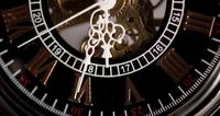Extreme close up of pocket watch with exposed machinery working from 5:25 to 5:58 in 4K time lapse