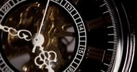 Extreme close up of pocket watch with exposed machinery working for a minute starting in 4:45 in 4K time lapse