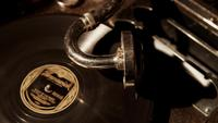 Close up shot of old record player, turntable and reproducer needle playing a antique disc in 4K