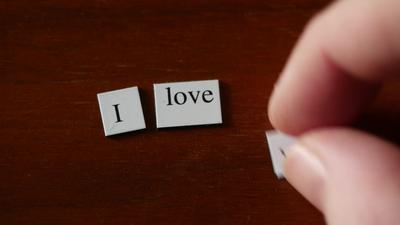 Hand placing words, I love you, on wood background | Free Stock Footage