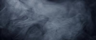 Smoke going up drawing a beautiful texture on dark background in 4K