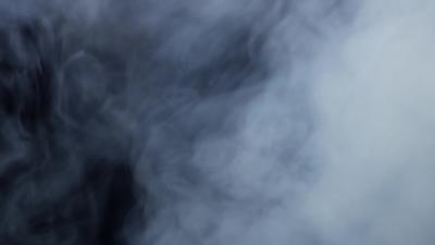Dense smoke going up creating a dynamic white texture in 4K