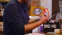Bartender-using-ipad-to-type-in-credit-card-free-stock-footage