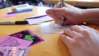 Hands making valentines at Valentine's Day party   Free Stock Footage