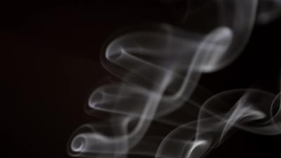 White smoke drawing beautiful rolls with transparency effect in 4K
