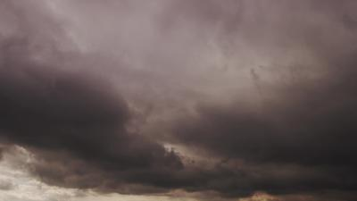 Big gray clouds moving fast to the camera preparing for the storm in 4K timelapse
