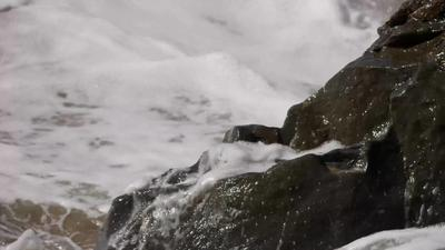 Sea Foam Splashing onto Rocks