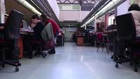 Time-lapse-office-with-women-walking-by