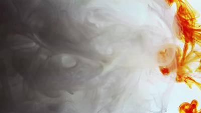 White And Orange Ink Moving In Water