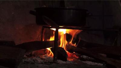 Indoor Wood Fire In Traditional Kitchen With Pan