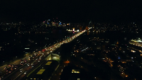 Traffic-on-harbor-bridge-at-night-4k