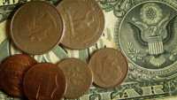 Close Up Of Dollar Bill And Six Coins Of Different Sizes